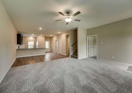 Open layout with a family room, dining room and kitchen.