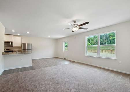 The spacious family room opens to the breakfast nook and kitchen, where a breakfast bar provides additional seating.