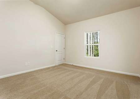 Alamance living room with vaulted ceilings, white window, and beige carpeting