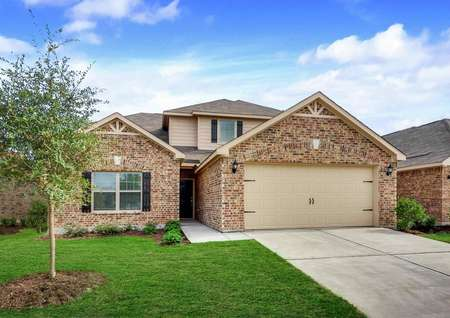 Cypress new home finished with landscaped front yard, two-car garage, and two living levels