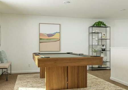 Rendering of loft area with pool table,   storage shelves, and artwork on wall.