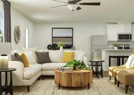 Rendering of living room with view from   kitchen area with large window, cabinet storage and tv above storage.