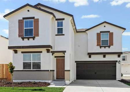 The Magnolia plan has a stunning stucco exterior with front yard landscaping.