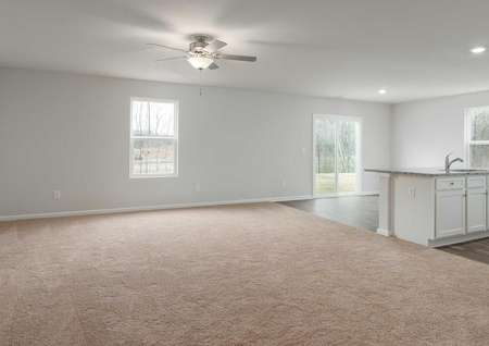 Avery great room with carpet flooring, recessed lighting, and ceiling fan