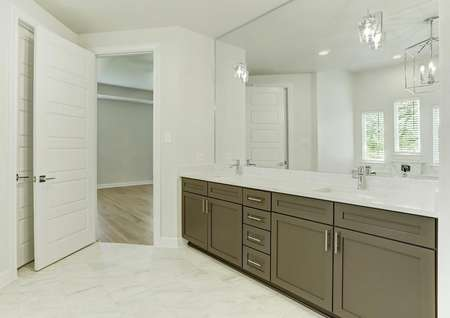 The master bath has a sparkling dual-sink vanity.