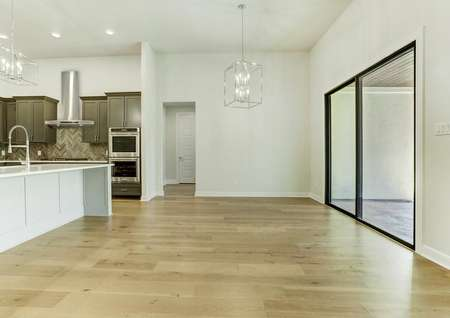 The dining area has designer lighting and quick access to the kitchen.