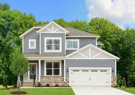 The Mid Atlantic Newport view of two story home with two car garage and covered porch.
