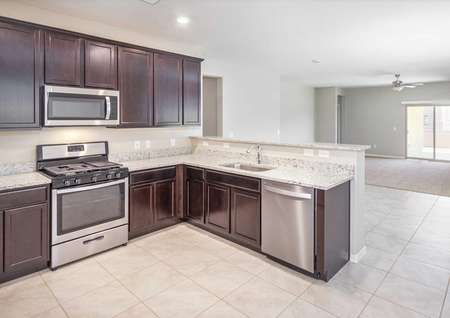 Prescott kitchen with stainless steel appliances, granite countertops, and espresso cabinets.