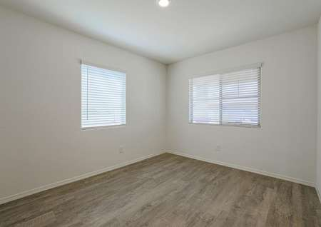 Spacious formal dining room with wood-style floors and incredible natural light from the double windows.