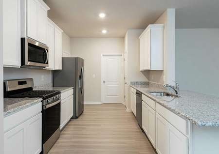 Burke kitchen with stainless appliances.
