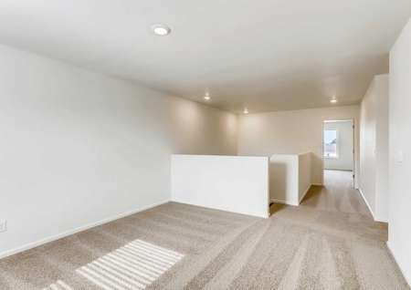 Harvard loft with carpet floor, recessed lighting, and white on white walls