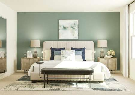 Rendering of the   spacious master bedroom with large window and carpeted flooring. The space is   decorated with a large cream-colored bed, two nightstands, a bench at the   foot of the bed, blue-and-white rug, large mirror and blue-green accent wall.