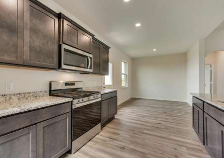 The kitchen is open to the dining room and has stunning vinyl plank flooring.