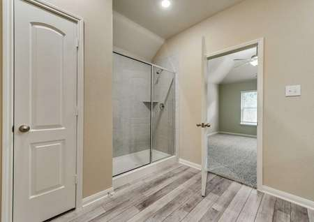 Ontario master bath with walk-in shower and modern flooring