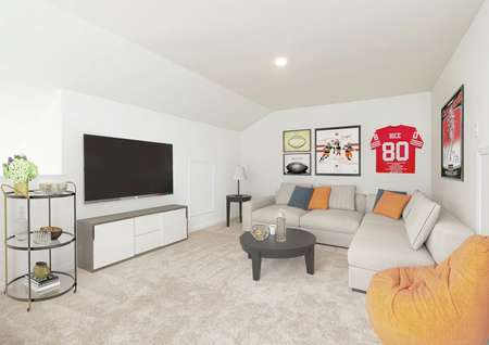 Game room decorated with sports memorabilia, large tv on wall, gray and orage pillows and orange bean bag.