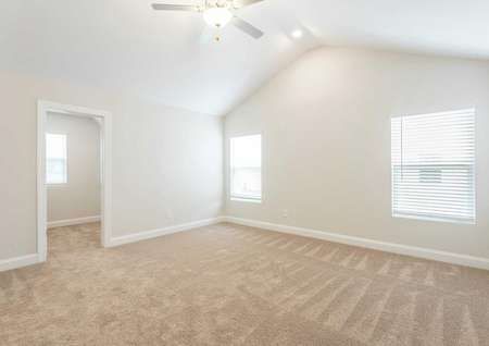 Hartford brown carpets, white trim, and ceiling fan