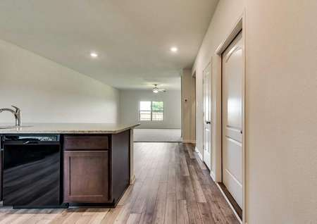 The kitchen is open to the dining room and living room in this open-concept plan.