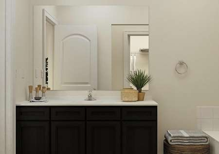 Rendering of the master bath in the Maple focused on the vanity with brown cabinetry.