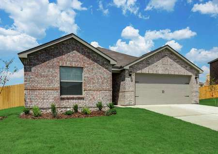 Sabine floor plan finished with brick siding, green grass, and two car garage