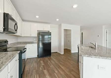 Allatoona finished kitchen with granite counters and black appliances