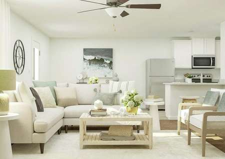 Rendering of living room with large   couch, additional seating, side table with lamp, and rectangular coffee   table.