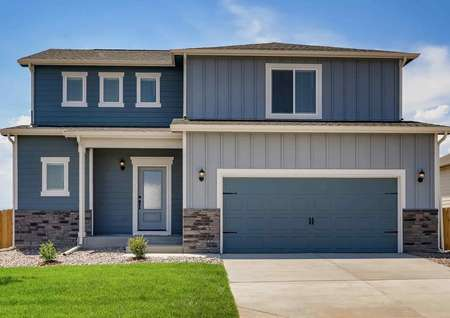 Mesa Verde exterior street view with multi-tone blue siding, stone accent wall, and green lawn