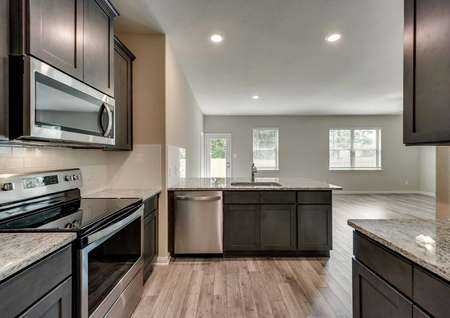 St. Clair kitchen with hardwood floors, granite countertops, and modern stainless steel appliances