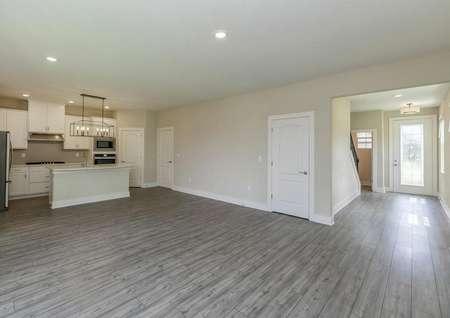 Open-concept layout showcasing a family room, chef-ready kitchen and the home's beautiful entrance.