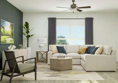 Rendering of the spacious living room in   the Roanoke with a large window and wood-style vinyl flooring. The room is   furnished with a sectional couch, accent chair, coffee table and media   center.