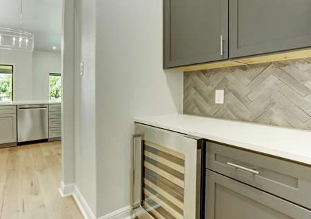 This home has a butler's pantry with beautiful cabinetry and a wine cooler.