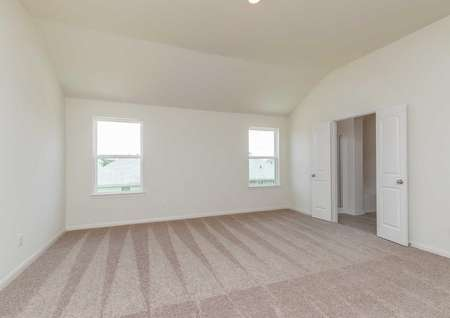 Osage floor plan master bedroom with carpet, double doors leading to the master bath, white walls and two windows