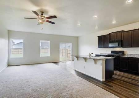 Gunninson great room with carpet floor, ceiling fan, and recessed lights