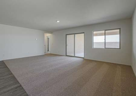 Family room with sliding doors that lead to the back yard.