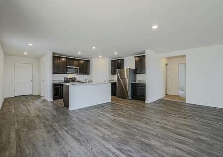Dining area connected to the kitchen with wood-style floors.