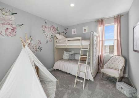 Mead kid's bedroom with bunk beds, white Victorian chair, and flower wall decals