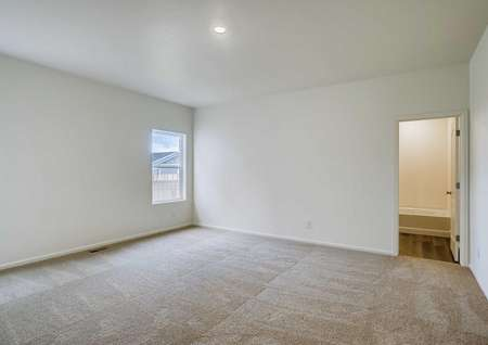 Gunninson bedroom with private bathroom, carpeted floors, and can light