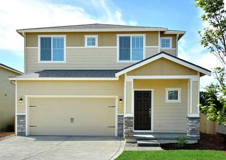 The Northwest Oak front exterior of this two story home with attached garage.