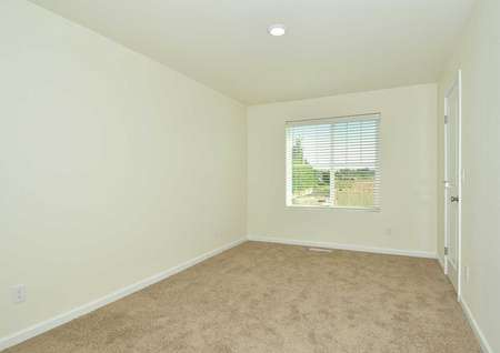The Northwest Oak second bedroom is shown carpeted and a single window on the back wall.