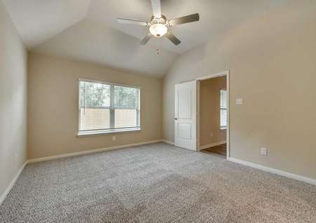 Ontario master bedroom with vaulted ceiling, ceiling fan with light kit and large window