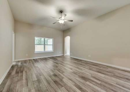 Ontario great room with ceiling fan, wood-looking floors, and white-trimmed walls