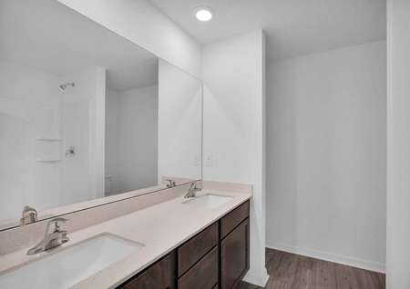The spacious master bathroom featuring double sinks.