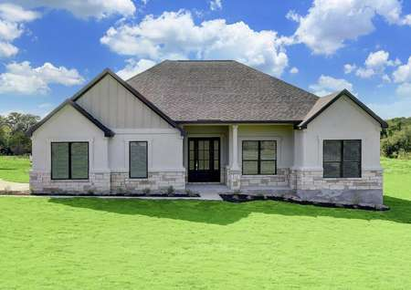 The Fairview has a stunning white stucco exterior accented with tan stone and siding.