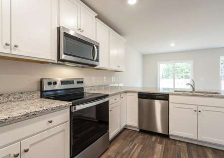 Ashley kitchen with stainless steel appliances.