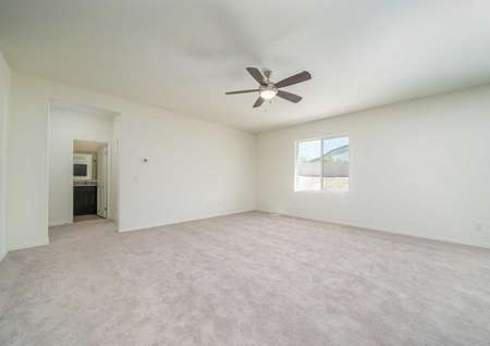 Venice master bedroom with private bath, overhead ceiling fan / light fixture, and carpeted floors