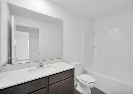 A secondary bathroom centrally located in the home.
