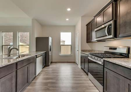 The kitchen has great natural light, stainless steel appliances and stunning granite countertops.