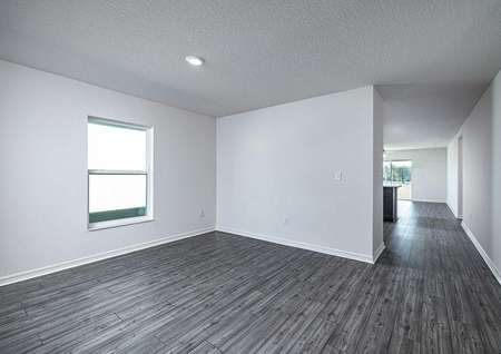 Foyer and dining room area leading to the home's kitchen and entertainment space.