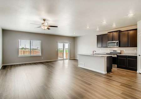 Pike plans living room area with hardwood flooring and view of the kitchen.