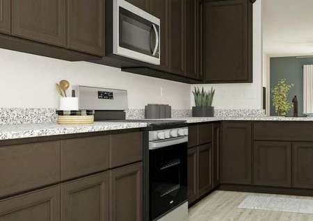 Rendering of the kitchen showing granite   countertops, dark brown cabinetry and Whirlpool brand appliances.