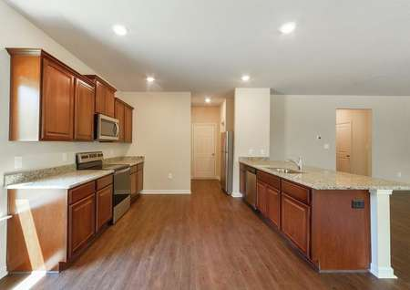 Spacious kitchen layout that features stainless steel appliances and overlooks the home's family room.